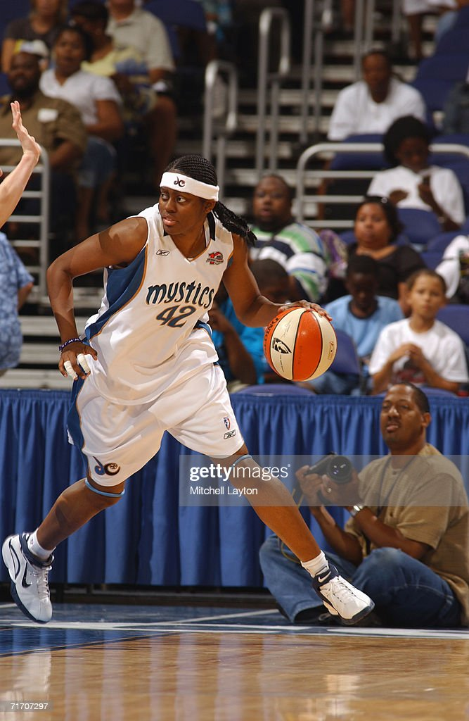 Nikki Teasley #42 of the Washington Mystics drives during a game against the Detroit Shock at MCI Center on August 11, 2006 in Washington, D.C. The Mystics won 78-66.