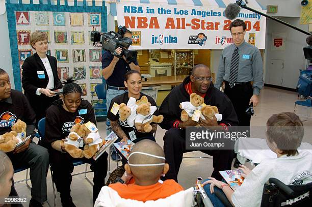 Nikki Teasley of the WNBA's Los Angeles Sparks Kay Malone and NBA legend Bob Lanier speak to children during the Read to Achieve Caravan Event at...