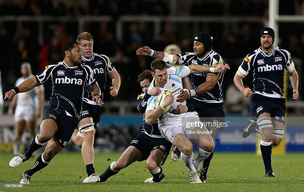 Nikki Walker of Worcester Warriors is tackled by Danny Cipriani of Sale Sharks during the Aviva Premiership match between Sale Sharks and Worcester Warriors at Salford City Stadium on December 28, 2012 in Salford, England.