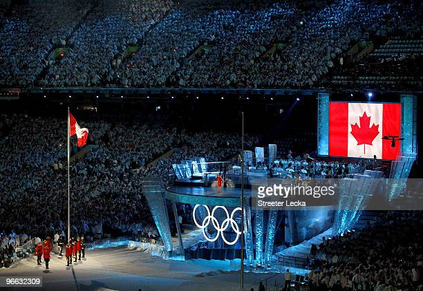 Nikki Yanofsky performs as Royal Canadian Mounted Police salute the Canadian flag after raising it during the Opening Ceremony of the 2010 Vancouver...
