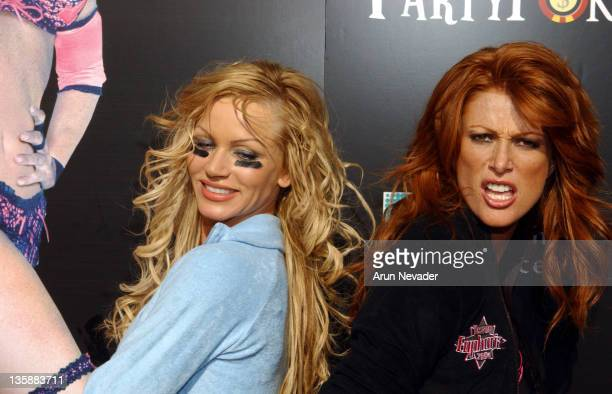 Nikki Ziering and Angie Everhart during Lingerie Bowl 2004 -- Arrivals at Los Angeles Coliseum in Los Angeles, California, United States.