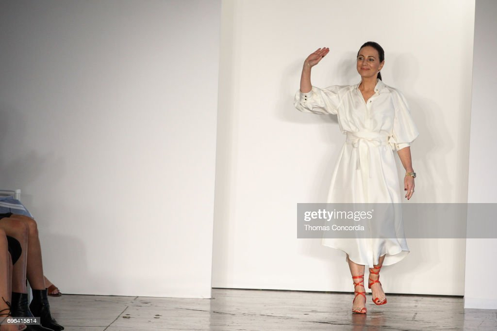 Nikki Zimmermann greets the audience after presenting the Zimmermann Resort 2018 Collection at Industria Studios on June 15, 2017 in New York City.