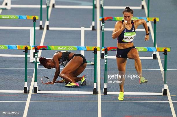 Nikkita Holder of Canada gets up after falling during the Women's 100m Hurdles Semifinals on Day 12 of the Rio 2016 Olympic Games at the Olympic...