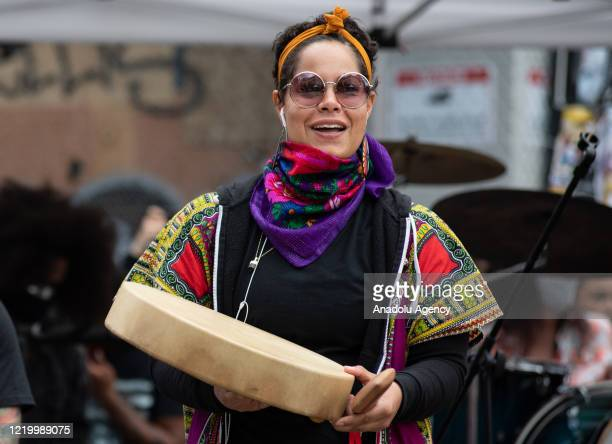 Nikkita Oliver, a community organizer holds a drum gifted to her from an indigenous tribe, inside the âCapitol Hill Organized Protestâ formerly known...