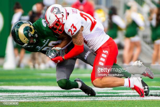 Nikko Hall of the Colorado State Rams is tackled by Marcus Hayes of the New Mexico Lobos after making a reception during the second half on October...