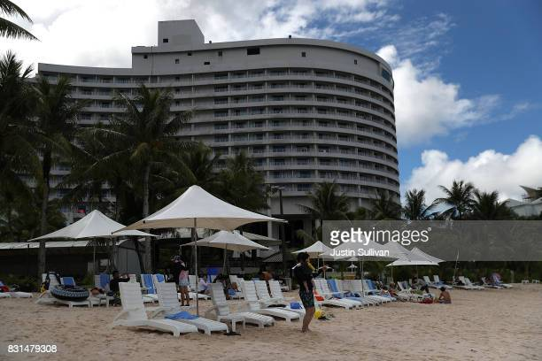 Nikko Hotel guest sit on lounge chairs at Gun Beach on August 15 2017 in Tamuning Guam The American territory of Guam remains on high alert as a...