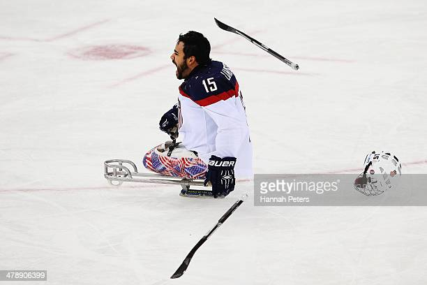 Nikko Landeros of the USA celebrates after winning the ice sledge hockey gold medal game between the Russian Federation and the United States of...