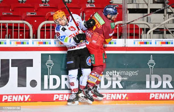 Niklas Andersen of the Fischtown Pinguins and Marc Zanetti of the Duesseldorfer EG during the game between the Duesseldorfer EG and the Fischtown...