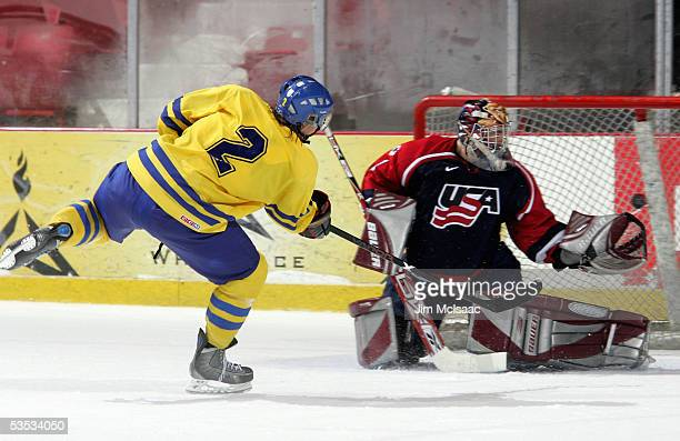 Niklas Andersson of Sweden scores against Jonathan Quick of the United States during USA Hockey's Junior Men's Summer Challenge on August 13, 2005 at...