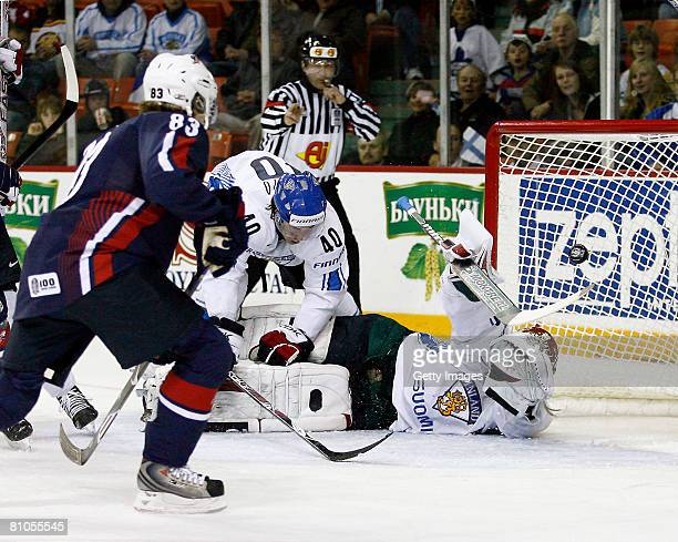 Niklas Backstrom of Finland stops the puck on a shot from Patrick Kane of the United States during the IIHF World Ice Hockey Championship...