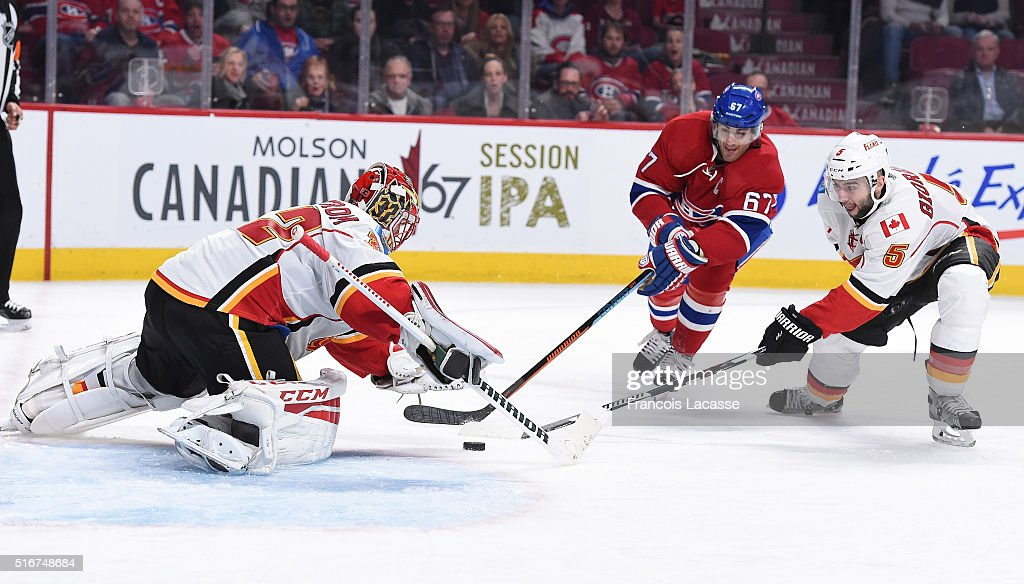 Niklas Backstrom #32 of the Calgary Flames stops a shot by Max Pacioretty #67 of the Montreal Canadiens in the NHL game at the Bell Centre on March 20, 2016 in Montreal, Quebec, Canada.