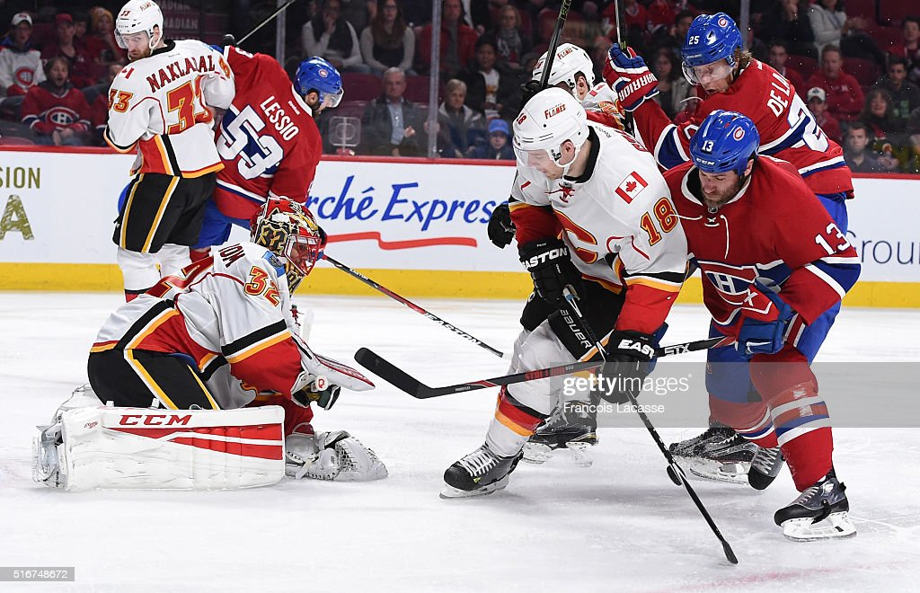 Niklas Backstrom #32 of the Calgary Flames stops a shot by the Montreal Canadiens in the NHL game at the Bell Centre on March 20, 2016 in Montreal, Quebec, Canada.