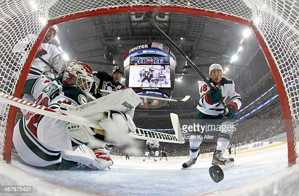 Niklas Backstrom of the Minnesota Wild can't make the save on Pascal Dupuis of the Pittsburgh Penguins during the game at Consol Energy Center on...