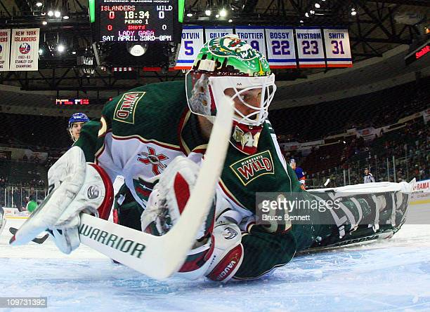 Niklas Backstrom of the Minnesota Wild searches for the puck during his game against the New York Islanders at the Nassau Coliseum on March 2 2011 in...