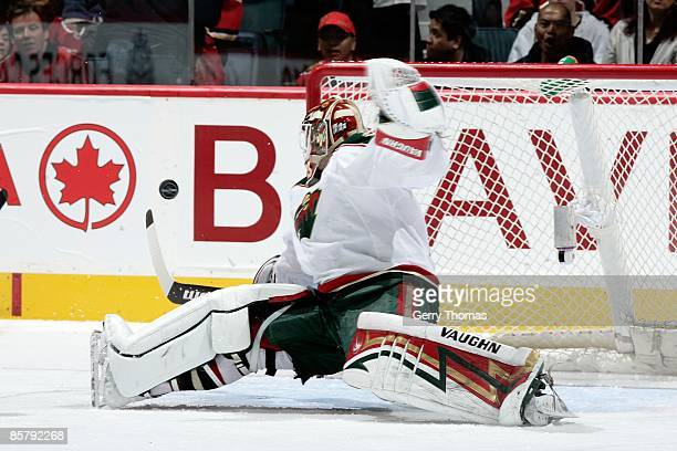 Niklas Backstrom of the Minnesota Wild sprawls to make a save against the Calgary Flames on March 28 2009 at Pengrowth Saddledome in Calgary Alberta...