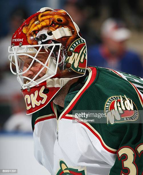 Niklas Backstrom of the Minnesota Wild tends net against the New York Islanders on March 25 2009 at the Nassau Coliseum in Uniondale New York
