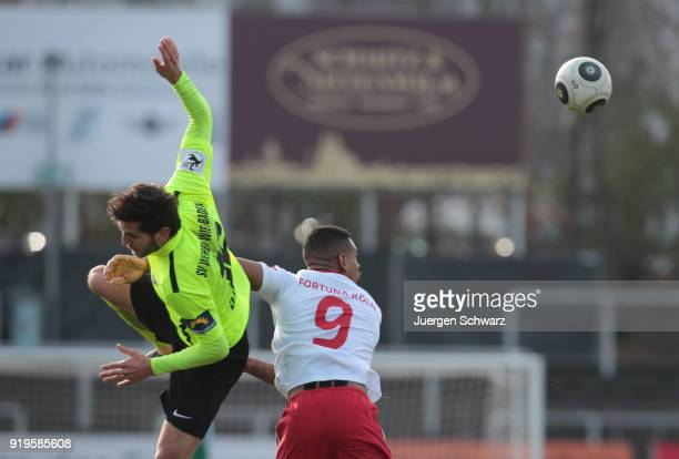 Niklas Dams of Wiesbaden and Daniel KeitaRuel of Cologne fight for the ball during the 3 Liga match between SC Fortuna Koeln and SV Wehen Wiesbaden...