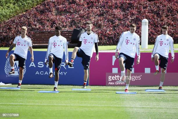 Niklas Dorsch David Alaba Sven Ulreich Niklas Suele and Marco Friedl exercise during a training session on day 3 of the FC Bayern Muenchen training...