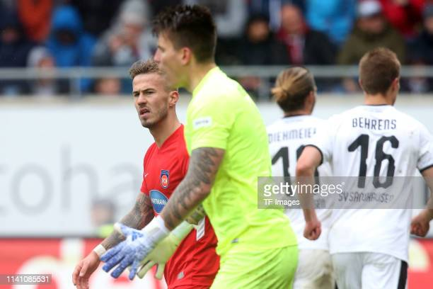 Niklas Dorsch of FC Heidenheim and goalkeeper Kevin Mueller of FC Heidenheim look dejected during the Second Bundesliga match between 1. FC...