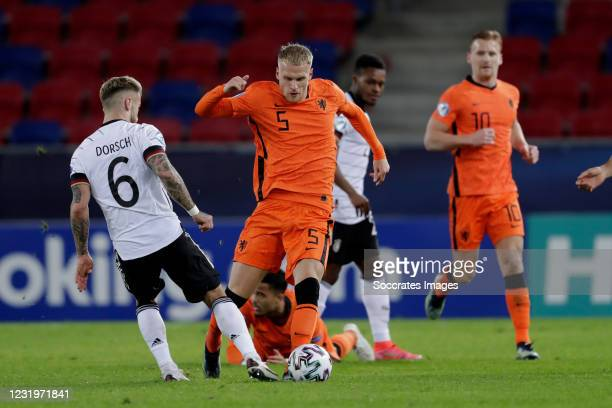 Niklas Dorsch of Germany U21, Mitchell Bakker of Holland U21 during the EURO U21 match between Germany v Holland at the Sosto Arena on March 27, 2021...