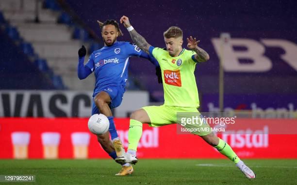 Niklas Dorsch of KAA Gent battles for the ball with Theo Bongonda of KRC Genk during the Jupiler Pro League match between KRC Genk and KAA Gent at...