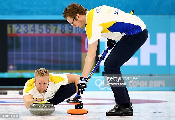 Niklas Edin and Viktor Kjaell of Sweden compete during the Bronze medal game between China and Sweden at the Ice Cube Curling Center on February 21...