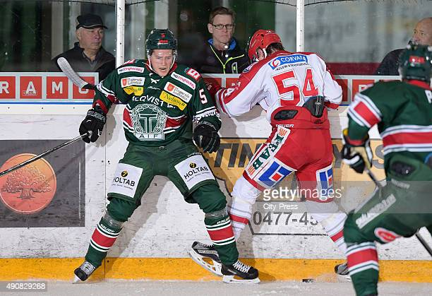 Niklas Enberg of Tingsryds AIF and Jonathan Dahlen of Timra IK fight for the puck during the HockeyAllsvenskan game between Tingsryd AIF and Timra IK...