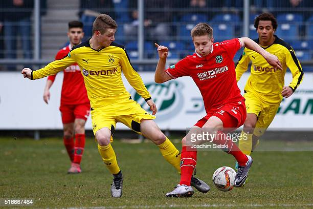 Niklas Feierabend of Hanover challenges Julian Schwermann of Dortmund during the DFB Juniors Cup Semi Final match between Hannover 96 and Borussia...