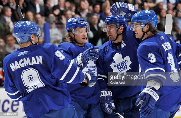 Niklas Hagman Mikhail Grabovski Francois Beauchemin and Garnet Exelby of the Toronto Maple Leafs celebrate a third period goal against the Ottawa...