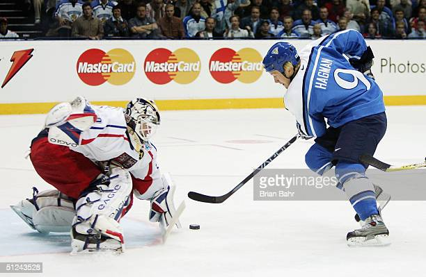 Niklas Hagman of Finland gets a one-on-one shot against goalie Tomas Vokoun of the Czech Republic but comes up empty in the first period during the...