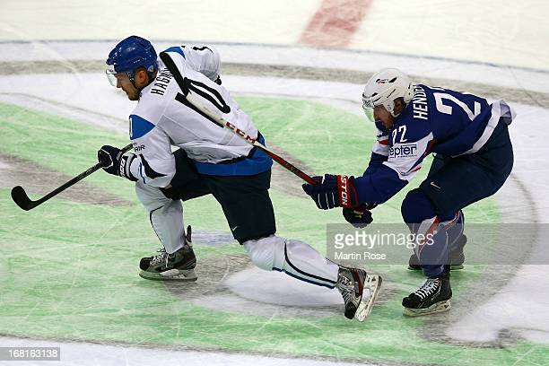Niklas Hagman of Finland skates against Brian Henderson of France during the IIHF World Championship group H match between Finland and France at...