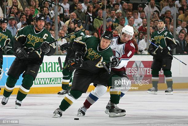 Niklas Hagman of the Dallas Stars battles for the puck with Wojtek Wolski of the Colorado Avalanche during the first period of Game two of the NHL...