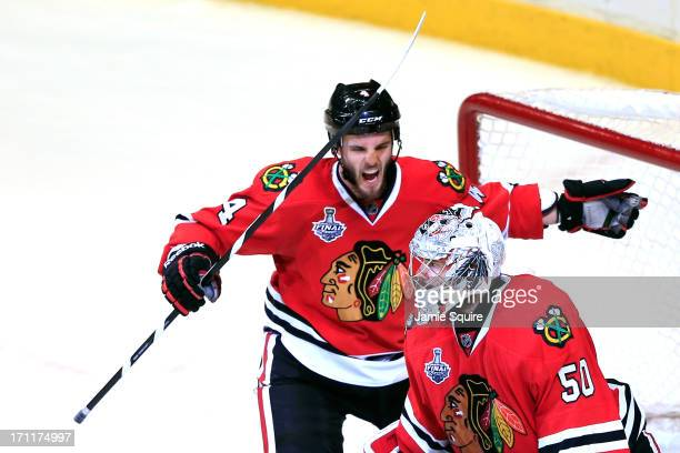 Niklas Hjalmarsson and Corey Crawford of the Chicago Blackhawks celebrate after defeating the Boston Bruins in Game Five of the 2013 NHL Stanley Cup...