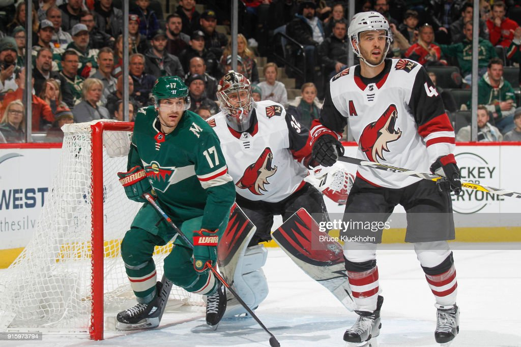 Niklas Hjalmarsson #4 and goalie Antti Raanta #32 of the Arizona Coyotes defend against Marcus Foligno #17 of the Minnesota Wild during the game at the Xcel Energy Center on February 8, 2018 in St. Paul, Minnesota.