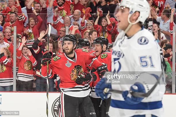 Niklas Hjalmarsson and Marian Hossa of the Chicago Blackhawks react after the Blackhawks scored against the Tampa Bay Lightning in the third period...