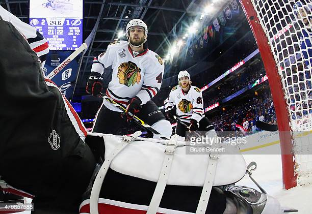 Niklas Hjalmarsson and Patrick Kane of the Chicago Blackhawks defend against the Tampa Bay Lightning during Game One of the 2015 NHL Stanley Cup...