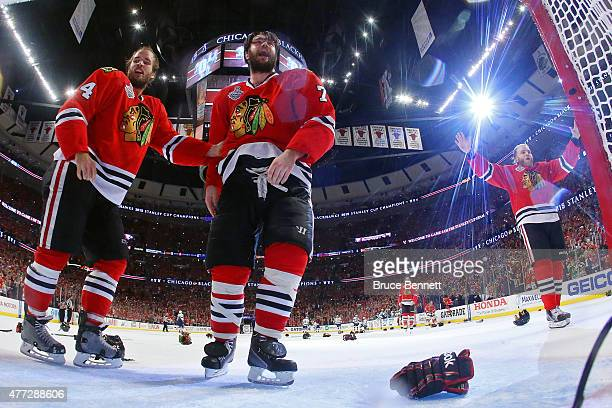 Niklas Hjalmarsson Brent Seabrook and Patrick Kane of the Chicago Blackhawks celebrate after defeating the Tampa Bay Lightning by a score of 20 in...