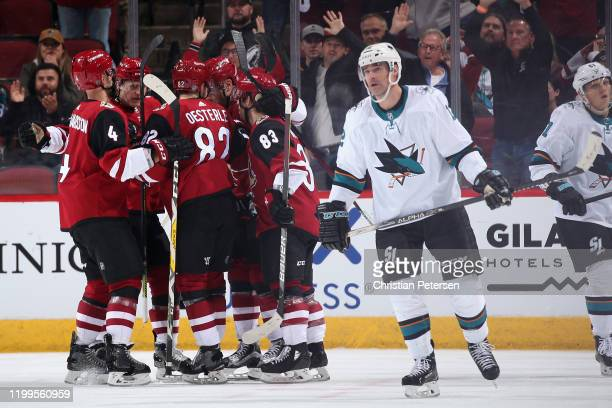Niklas Hjalmarsson Christian Dvorak Jordan Oesterle Taylor Hall and Conor Garland of the Arizona Coyotes celebrate after Hall scored a goal against...