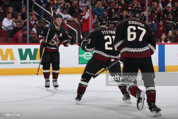 Niklas Hjalmarsson, Derek Stepan and Lawson Crouse of the Arizona Coyotes celebrate after Stepan scored a goal against the Pittsburgh Penguins during...