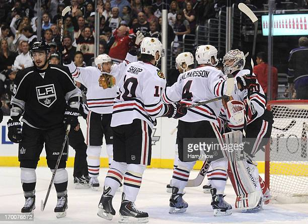 Niklas Hjalmarsson Michal Handzus and Patrick Sharp of the Chicago Blackhawks skate toward goaltender Corey Crawford as Marian Hossa celebrates after...