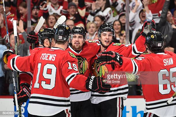 Niklas Hjalmarsson of the Chicago Blackhawks celebrates with teammates including Erik Gustafsson after scoring against the Buffalo Sabres in the...