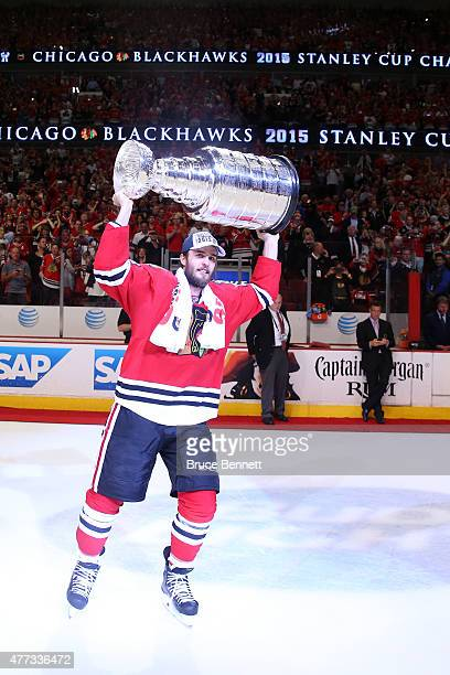 Niklas Hjalmarsson of the Chicago Blackhawks celebrates with the Stanley Cup after defeating the Tampa Bay Lightning by a score of 2-0 in Game Six to...