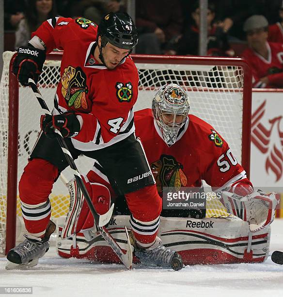 Niklas Hjalmarsson of the Chicago Blackhawks clears the puck in front of Corey Crawford against the Anaheim Ducks at the United Center on February...
