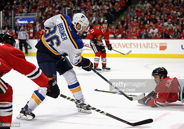 Niklas Hjalmarsson of the Chicago Blackhawks dives to stop a shot by Troy Brouwer of the St Louis Blues at the United Center on January 24 2016 in...