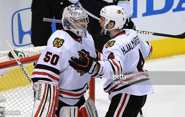 Niklas Hjalmarsson of the Chicago Blackhawks shouts after they defeated the Los Angeles Kings 32 as goaltender Corey Crawford looks on in Game Four...