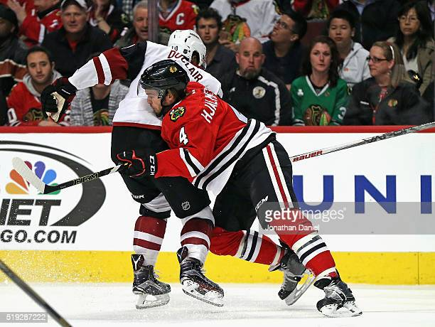 Niklas Hjalmarsson of the Chicago Blackhawks stops Anthony Duclair of the Arizona Coyotes from advancing the puck at the United Center on April 5...