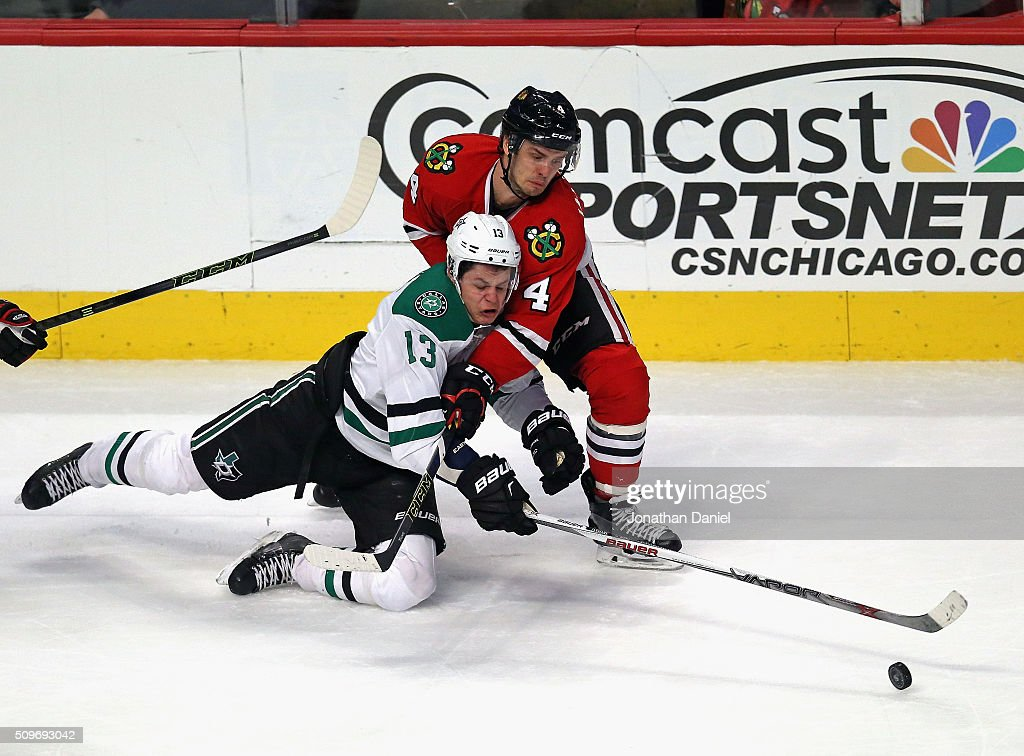 Niklas Hjalmarsson #4 of the Chicago Blackhawks takes down Mattias Janmark #13 of the Dallas Stars at the United Center on February 11, 2016 in Chicago, Illinois. The Stars defeated the Blackhawks 4-2.