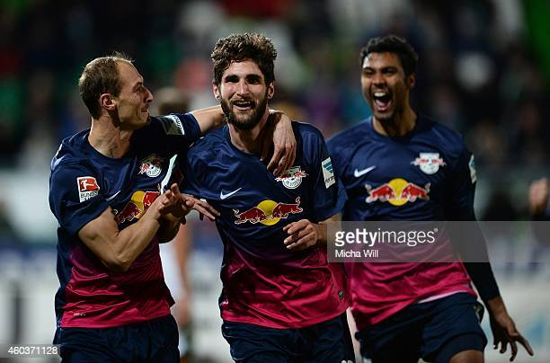 Niklas Hoheneder of Leipzig celebrates with Matthias Morys and Marvin Compper of Leipzig after scoring the opening goal during the Second Bundesliga...
