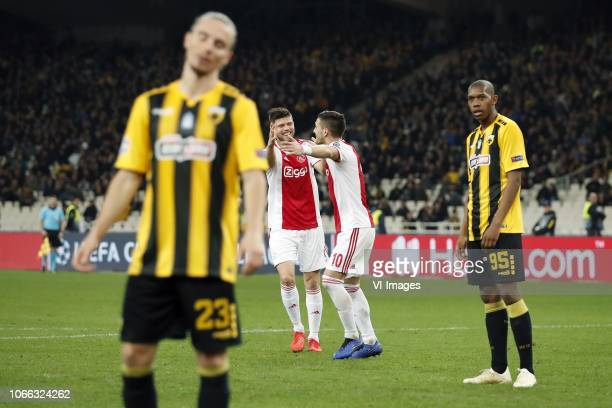 Niklas Hult of AEK Athens Klaas Jan Huntelaar of Ajax Dusan Tadic of Ajax Alef of AEK Athens during the UEFA Champions League group E match between...