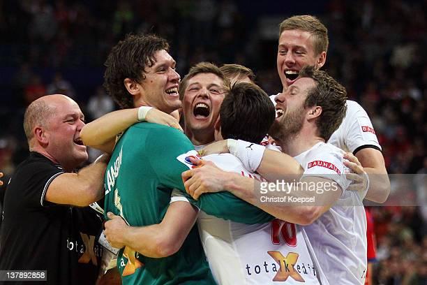 Niklas Jacobsen, Lasse Svan Hanssen, Nikolaj Markussenen, Kasper Nielsen of Denmark celebrate the 21-19 victory after the Men's European Handball...